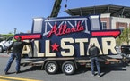 Workers load an All-Star sign onto a trailer after it was removed from Truist Park in Atlanta on April 6. The game is being moved to Coors Field in De