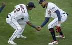 Luis Arraez and Byron Buxton celebrated Thursday's victory.