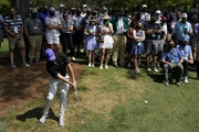 Rory McIlroy hits out of the rough on the sixth hole during the first round of the Masters