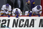 Minnesota State Mankato players hung their heads in disappointment after losing 5-4 in the men's hockey national semifinal to St. Cloud State.