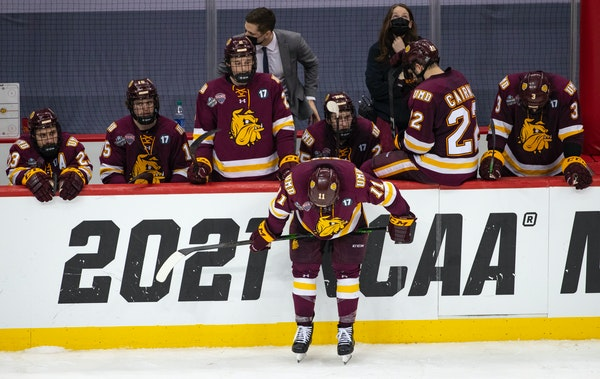 UMD players reacted to losing to UMass, 3-2 in overtime. The Bulldogs had their hopes of an NCAA record fourth straight national championship appearan