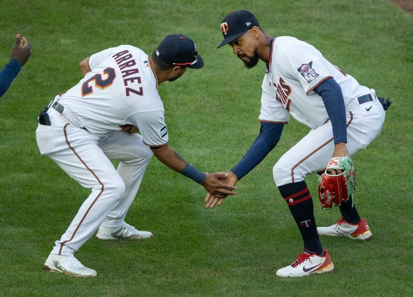 Luis Arraez (2) and Byron Buxton (25) of the Minnesota celebrated at the end of the game.