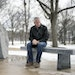 St. Cloud Mayor Dave sits on a memorial bench, dedicated to his brother, at Wilson Park in St. Cloud. Kleis' brother, a veteran, killed himself duri