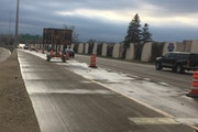 Signs warn drivers that westbound I-694 in New Brighton will be closed this weekend.