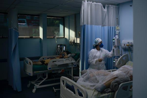 COVID-19 patients are treated in the municipal hospital of Sao Joao de Meriti, Rio de Janeiro state, Brazil, Thursday, April 8, 2021. (AP Photo/Felipe