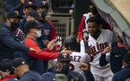 Luis Arraez was congratulated after his two-run homer in the Twins' 10-2 victory over Seattle at Target Field on Thursday.