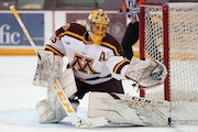 Gophers goalie Jack LaFontaine made a glove save in the team's March 6 game against Michigan.
