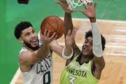 Boston Celtics forward Jayson Tatum (0) goes to the basket against Minnesota Timberwolves forward Jaden McDaniels (3) during the second quarter of an