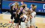 Chaska teammates celebrated their 45-43 win against Rosemount.