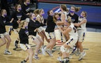 Chaska teammates celebrated their 45-43 win against Rosemount.