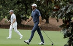 Dustin Johnson walks up the 18th fairway during the second round of the Masters