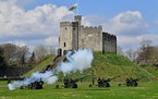 Members of the 104th Regiment Royal Artillery fire a 41-round gun salute in the grounds of Cardiff Castle, to mark the death of Prince Philip, in Card