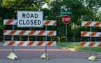 Road closure signs blocked off West River Parkway in Minneapolis for walkers and bicyclists in June.