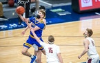 Hayfield�s Ethan Slaathaug goes up for a layup in the first half of the Class 1A championship Saturday afternoon. Photo by Earl J. Ebensteiner, Spor