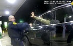 In this image made from Windsor Police video, a police officer uses a spray agent on Caron Nazario on Dec. 20, 2020, in Windsor, Va. Nazario, a second