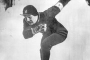 Bob Fitzgerald of Minneapolis, shown crossing the finish line with a record of 43.4 in the 500-meter speed skating race in the Olympics at St. Moritz,