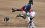 Seattle's J.P. Crawford beat the throw to first base as the Twins' Miguel Sano reaches for he ball during the eighth inning.