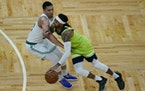 Timberwolves guard D'Angelo Russell drives against Boston forward Grant Williams