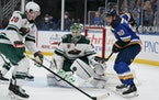 St. Louis Blues' Ryan O'Reilly (90) watches the puck as Wild goaltender Kaapo Kahkonen and Ryan Suter defend during the second period Friday night