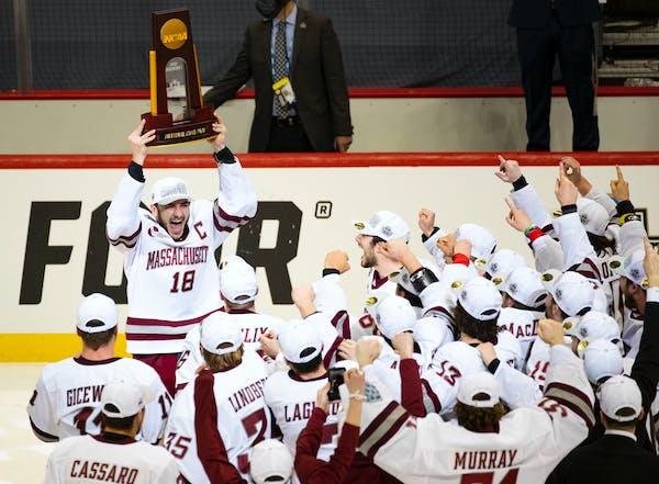 Massachusetts forward Jake Gaudet yelled in celebration while holding the NCAA men's hockey national championship trophy