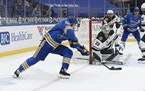 St. Louis Blues' Ryan O'Reilly scores the winning goal past the Wild's Cam Talbot during overtime of Saturday's game.