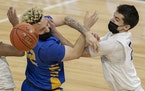 Kody Williams (22) of Wayzata was fouled by Keegan Hilger (2) of Cretin-Derham Hall in the second half.