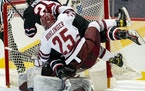 St. Cloud State's  Nick Perbix and Massachusetts'  Aaron Bohlinger both collided with Minutemen goalie Filip Lindberg in the first period of the c