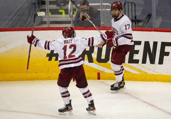 Massachusetts forward Garrett Wait (12) celebrated with Philip Lagunov after Lagunov's shorthanded goal in the second period made it 3-0.