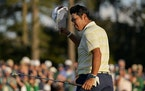 Hideki Matsuyama tipped his cap to the crowd after winning the Masters on Sunday.