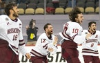 University of Massachusetts men's hockey players rushed onto the ice to celebrate after defeating St. Cloud State 5-0 Saturday to claim the program�