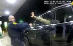 In this image made from Windsor, (Va.) Police video, A police officer uses a spray agent on Caron Nazario on Dec. 20, 2020, in Windsor, Va. Nazario, a