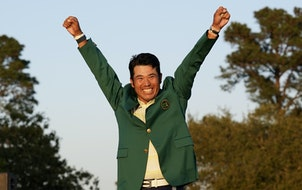 Hideki Matsuyama raised his arms in triumph after putting on the champion's green jacket for his victory at the Masters on Sunday.