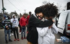 Mayah Varnado, right, is embraced by Olivia Williams as Varnado was overcome with emotion at 63rd Avenue North and Lee Avenue North, Sunday, April 11,