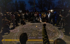 A crowd formed a circle around a memorial for Daunte Wright in Brooklyn Center on Sunday, April 11, after Wright was fatally shot by police during a t