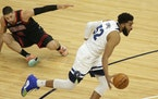 Wolves center Karl-Anthony Towns left Bulls counterpart Nikola Vucevic behind on the floor during the first quarter Sunday night at Target Center.
