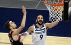 Wolves guard Ricky Rubio shot as Bulls guard Tomas Satoransky defended Sunday night.