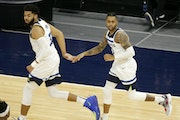Karl-Anthony Towns and D'Angelo Russell celebrated a basket against the Bulls during Sunday night's victory.