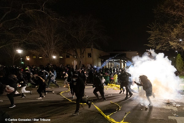 Officers fired dispersants into a crowd of as many as 500 protesters outside the Brooklyn Center police headquarters on Sunday night. Looting was also