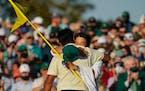 Hideki Matsuyama embraced caddie Shota Hayafuji after winning the Masters.