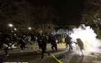 Officers fired dispersants into a crowd of as many as 500 outside the Brooklyn Center police headquarters and the mayor declared an overnight curfew a