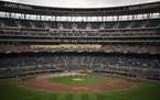 Players stood at Target Field before the Twins home opener on Thursday.