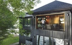 """Ali and Debbie Awad built a modern home at the site of an """"unbuildable"""" lot in Burnsville."""