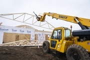 Workers build a new home in Woodbury in March 2020. A legal challenge by a trade group representing builders has targeted two small cities in Hennepin