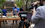 Chefs Christina Nguyen and Yia Vang filmed a segment for Minnesota Rice, a fundraiser for the Coalition of Asian American Leaders, at Nguyen's home