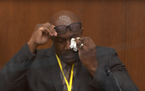 Philonise Floyd, brother of George Floyd, wipes away a tear during his testimony in the Derek Chauvin murder trial on Monday.