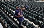 Twins fan Zack Kellner of Minneapolis left Target Field after the team announced that the series opener against Boston was postponed Monday.