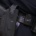 West Hennepin Public Safety Sgt. Rick Dennison showed off a gun equipped with one of the cameras made by Viridian Weapon Technologies in a holster. Th