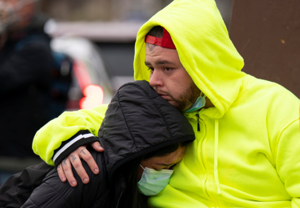 Daunte Wright's brother, Damik, hugged a friend, before a vigil on Monday, April 12, in Brooklyn Center.