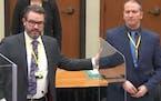 Defense attorney Eric Nelson and client Derek Chauvin  Credit: Court TV/Pool