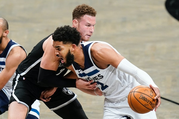 Karl-Anthony Towns of the Wolves drove past Brooklyn's Blake Griffin during a game in New York on March 29.